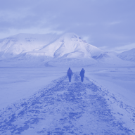 two people walking down a path in the arctic